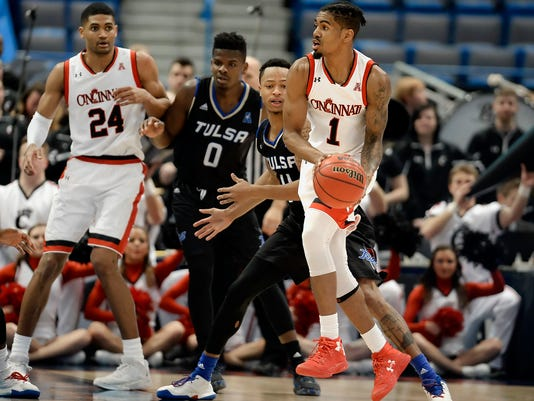 Cincinnati's Jacob Evans looks to pass as Tulsa's Pat Birt, behind, defends during the second half of an NCAA college basketball game in the American Athletic Conference tournament quarterfinals, Friday, March 10, 2017, in Hartford, Conn. (AP Photo/Jessica Hill)