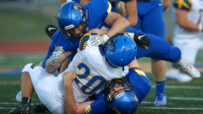 Nickerson's Keaton Nevins is tackled by two Circle defenders in the first quarter Monday at Circle High School. Nevins finished with 78 yards on 22 carries.