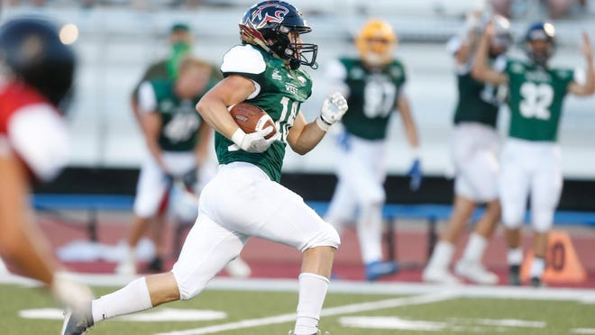 Great Bend player Dalton Miller runs the ball 44-yards for a West team touchdown in the third quarter of the Shrine Bowl at Hummer Sports Park Saturday. The West took a 14-9 win over the East.