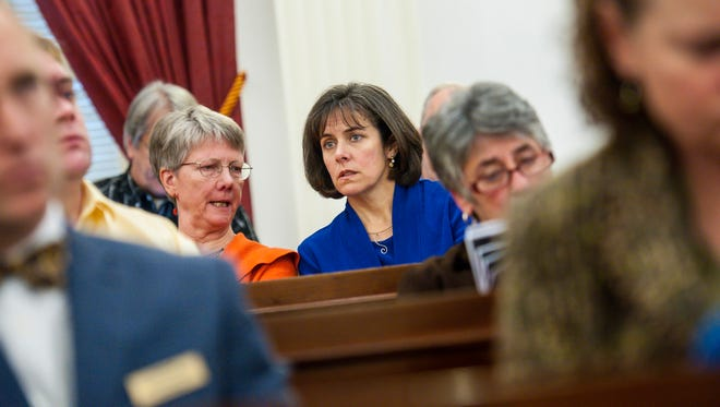 Rep. Mitzi Johnson of South Hero, the Democratic frontrunner for speaker of the House, center right, listens to a briefing on the state budget gap for legislators from economist Tom Kavet at the Statehouse in Montpelier on Wednesday.