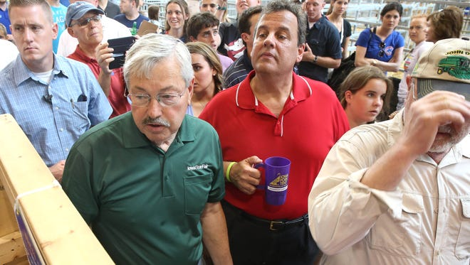 New Jersey Gov. Chris Christie, right, gets a tour of the Iowa State Fair grounds with Iowa Gov. Terry Branstad at the Iowa State Fair on Saturday, Aug. 22, 2015, in Des Moines, Iowa.