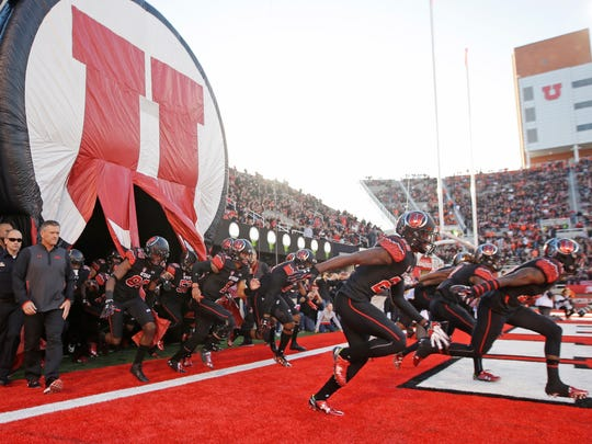 Utah head coach Kyle Whittingham enters the field with his team before their NCAA college football game against Oregon State on Saturday.