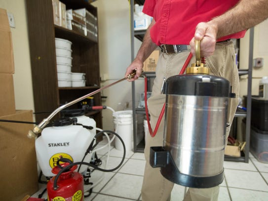 Jeff Murray, owner of Bug Guy Pest Control, shows an industrial pest sprayer that the company uses for some pest control situations. Friday Feb 23, 2018