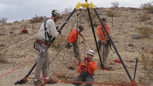 Members of the San Bernardino County Cave and Technical Rescue team descend into a mine as part of the search for Erin Corwin on July 19. It was this cave team that found Corwin's body at the bottom on of an abandoned gold mine on August 16. The mine featured in this picture is not the mine where Corwin was found, but it is in the same general area.