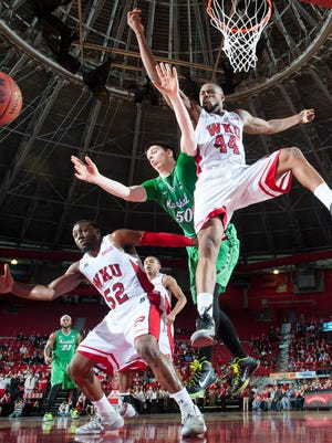 Jan 4, 2015; Bowling Green, KY, USA; Western Kentucky Hilltoppers forward George Fant (44) and guard T.J. Price (52) fight for possession with Marshall Thundering Herd forward Milan Mijovic (50) during the game at E.A. Diddle Arena. Mandatory Credit: Joshua Lindsey-USA TODAY Sports