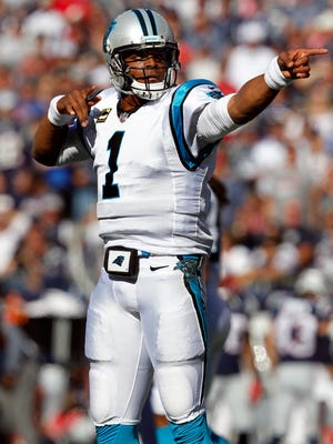 Carolina Panthers quarterback Cam Newton (1) celebrates a first down run during the third quarter against the New England Patriots at Gillette Stadium.