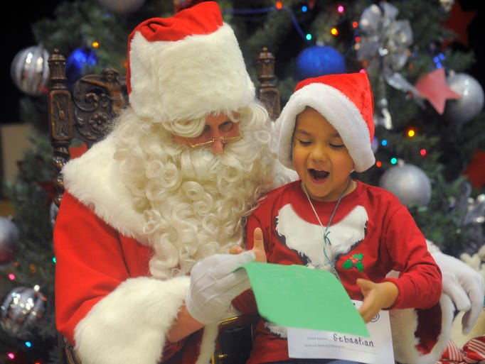 Sebasian Osorio, 5, reacts as he shows his wish list