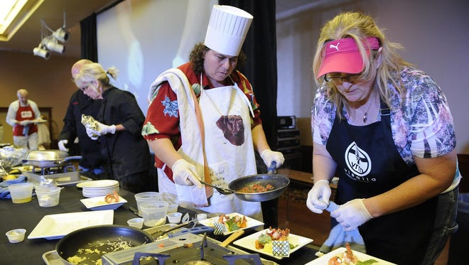 Celebrity chefs compete in the annual Food Fight Against Hunger at the Holiday Inn in this file photo from July 2012.