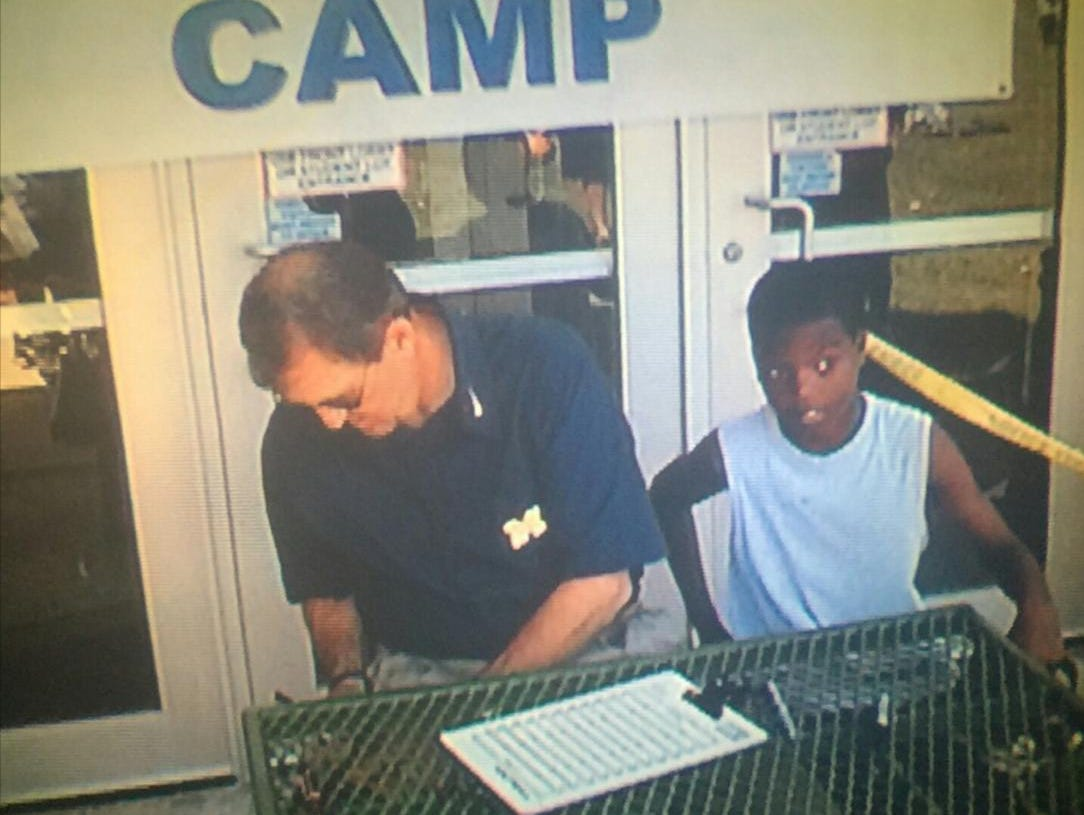 Former Michigan coach Lloyd Carr and Donnie Corley at a camp in 2005.