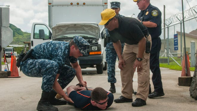 U.S. Naval Base Guam Security personnel simulate a vehicle-based improvised explosive device in this file photo from Exercise Citadel Pacific 2014, which tested the readiness of the military to respond to threats.