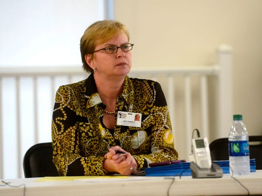 Vikki Garrett, with the West Florida Regional Planning Council, listens to Pensacola Beach leaseholders during an open forum on Thursday to get input on what services should be provided by the Santa Rosa Island Authority and how they should be funded.