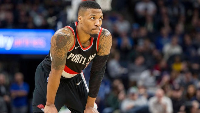 Portland Trail Blazers guard Damian Lillard (0) looks on during the second half against the Minnesota Timberwolves at Target Center.