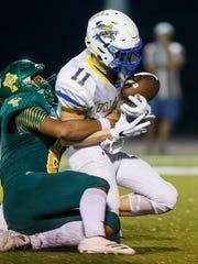 Springfield Catholic's Tyson Riley forces the fumble