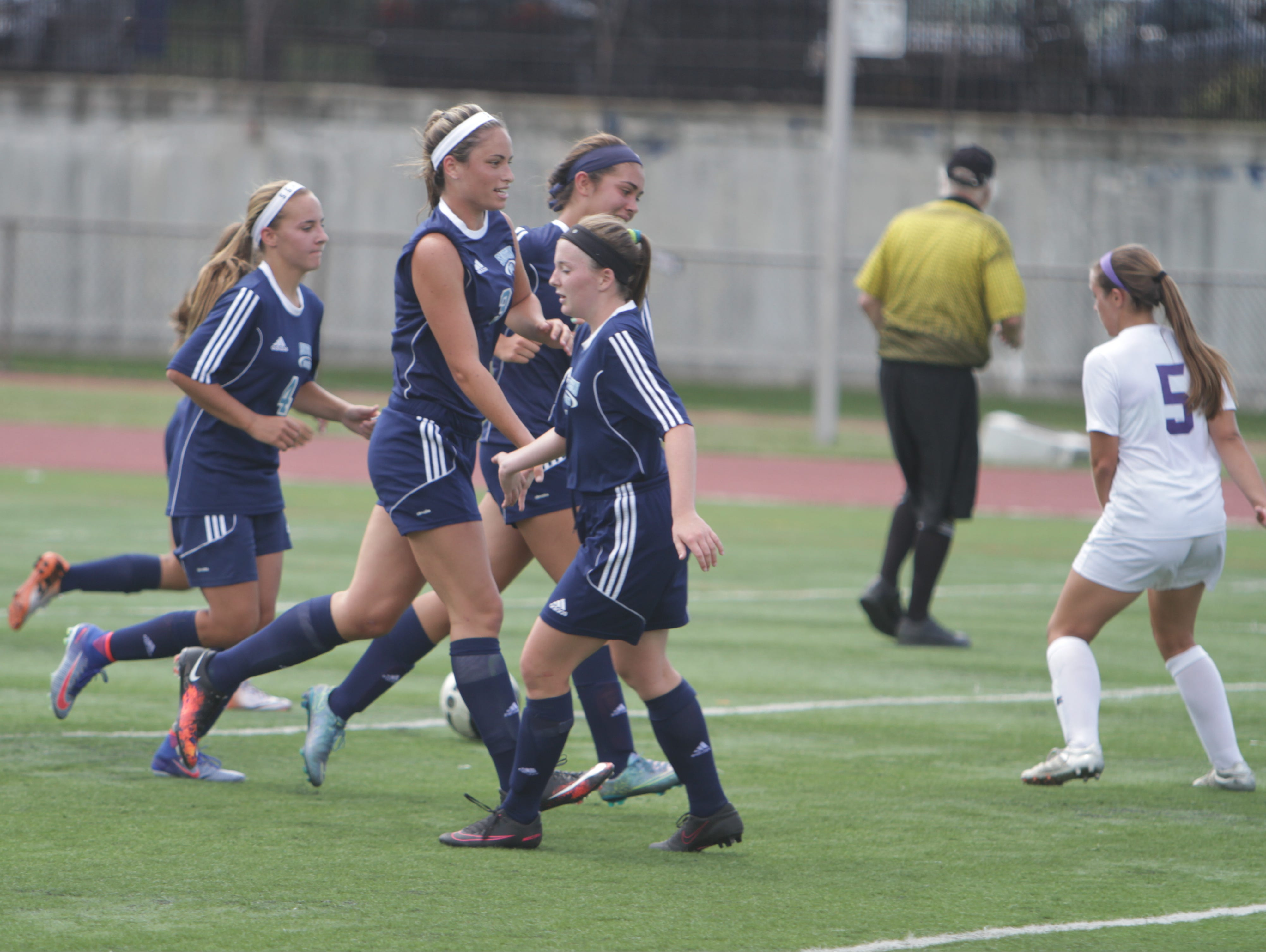 Suffern celebrates after a Kyra Greenbaum's first half goal during a Section 1 girls soccer game between New Rochelle and Suffern at New Rochelle High School Friday, Sept. 2. Suffern won 4-1.