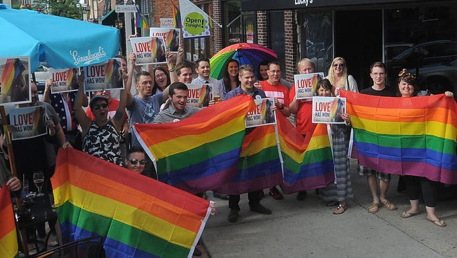 A crowd gathers to celebrate in downtown Sioux Falls in honor of the Supreme Court's decision for marriage equality in all 50 states on Friday, June 26, 2015.