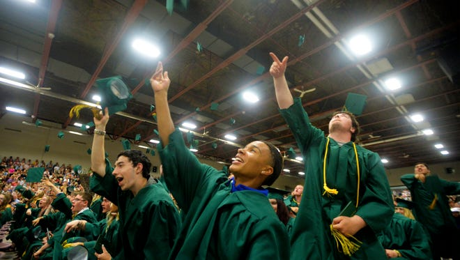 Graduates toss their caps at the conclusion of the C.M. Russell High School Class of 2018 commencement ceremony on Sunday, May 27, 2018, in the Four Seasons Arena.  CMR graduated 287 seniors on Sunday.