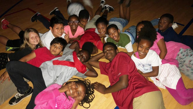 Shairee, Jabenske, Milton, Alyssa, Jonatan, Alonna, Jahad, Smyah, Semaj, Bertram, Candace, Harmony and Jarvarius enjoy the party at the Bill & Barbara Whitman Boys & Girls Club in Indiantown.