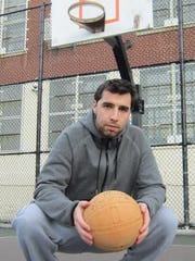"Former Rowan University standout Tyson Hartnett has written a book entitled ""Hoop Dreams Fulfilled, An Athlete's Failures and Redemption on His Journey to Professional Basketball."""