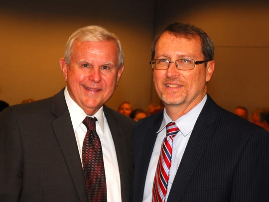 The late Norm Wolfinger poses with Phil Archer before Wolfinger swore in Archer as the new State Attorney for Brevard and Seminole County in a ceremony at the Moore Justice Center in Viera. Archer continues defending convictions won during Wolfinger's tenure. MALCOLM DENEMARK/FLORIDA TODAY