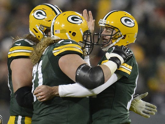 Packers quarterback Aaron Rodgers, right, celebrates