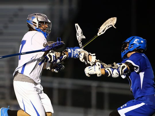 Cedar Crest's Raymond Moore (17) takes a shot during the Falcons' 14-10 home loss on Tuesday to Elizabethtown.