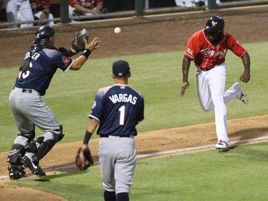 El Paso Chihuahuas baserunner Jose Pirela is caught in a rundown between third base and home plate Tuesday at Southwest University Park. Reno Aces catcher Hank Conger finally gets the throw and the tag.