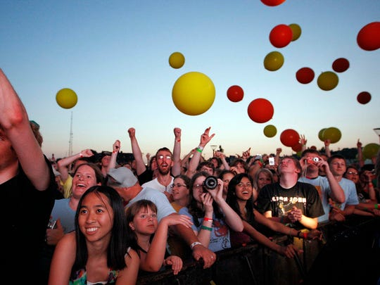 Many balloons in the air as fans react to the Flaming Lips on the main stage at the the first 80/35 Music Festival, Friday evening, July 4, 2008.