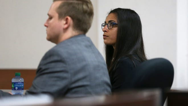 """Sarah Walker sits with her attorney Aaron Wayt during the first day of her trial on charges of DUI manslaughter stemming from the April 2014 crash that killed William """"Rusty"""" Fowler."""