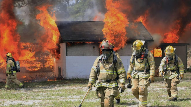 Port Orange firefighters train on a burning building Friday, May 29, 2020. Two Port Orange firefighter-paramedics have tested positive for the coronavirus, according to the city.