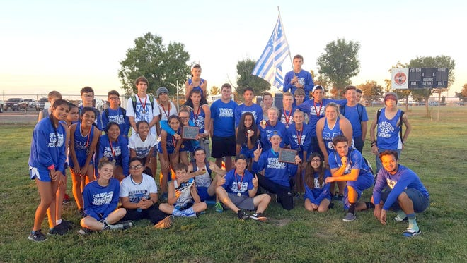 The Cavemen won Thursday's Artesia Invitational, while the Cavegirls came in second place.