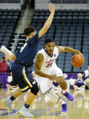 University of Evansville guard Duane Gibson (25) drives past Mount St. Joseph guard Andrew Finley (20) during their game at the Ford Center in Evansville, Thursday, Dec. 22, 2016. The University of Evansville beat Mount St. Joseph 68-55.