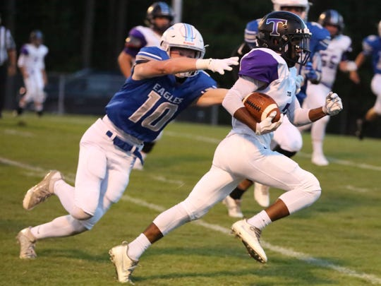 TCA's Kevin Davis tries to evade Jackson Christian's Graham Scott during a game in 2017.