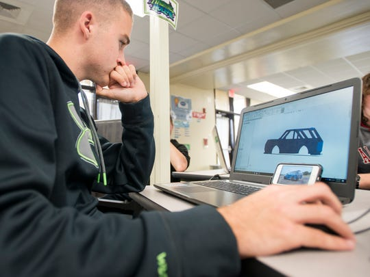 Seth Addington, 17, works on a 3D rendering of his car during manufacturing class at Milton High School on Monday, December 4, 2017.  The Santa Rosa County School District would like to create an Innovation High School to prepare students for future work and careers in fields such as cybersecurity, IT, aerospace and engineering.