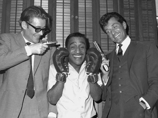 "British actor Peter O'Toole, left, has a laugh with singer Sammy Davis Jr., centre, and actor Hugh O'Brian, following Davis' performance in ""Golden Boy"" at the Majestic Theatre, New York, February 24, 1965."