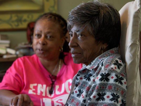 Antoinetta Jackson, left, takes care of her mother