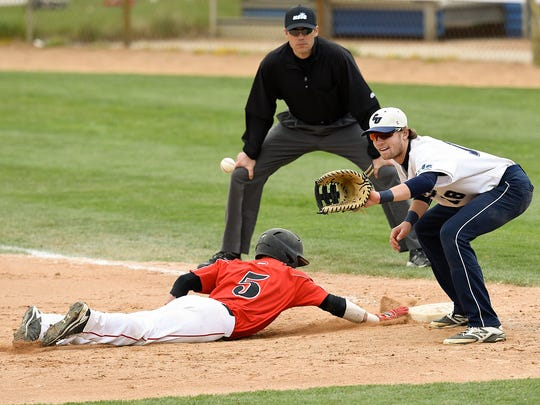 St. Cloud State's Judd Davis just makes it back into first under the tag attempt by Concordia's Roch Whittaker during the fifth inning of the NSIC championship game Sunday, May 15, at Joe Faber Field in St. Cloud.