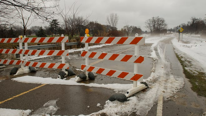 Barricades block a sunken section of road Monday, Dec. 26, on St. Clair Highway between Palmer and Oak Streets in St. Clair.