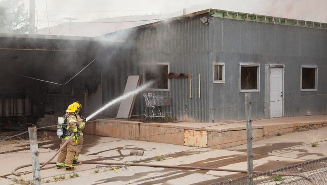 St. George firefighters respond to a suspicious warehouse fire near 600 East Friday, March 11, 2016.