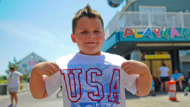 Marcus Ramirez-Ianasa, of Baltimore, shows off his USA pride during the olympics while he is visiting Ocean City on Thursday, Aug. 11.