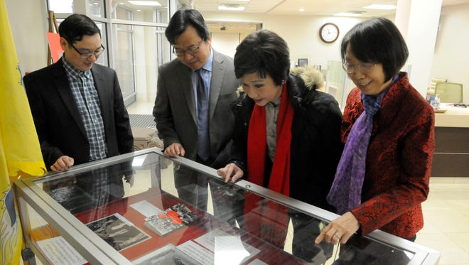 From left, Fukein American Association of New Jersey President David Guo, Fukein American Association Chairman Tommy Xie, founder of the New Jersey Chinese Festival Margaret Lam, and Aiyi Lu, of the Fukien American Association, view a display at the Belleville Public Library and Information Center on Feb. 6 detailing Belleville's Chinese history.