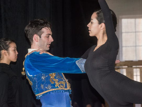 Samantha Ayala Amaya, right, dances with Patrick VanBuren.