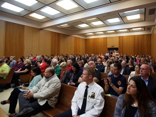 Mount Pleasant officials and residents attend a meeting Monday at Town Hall about security concerns at  two residential centers for teens.
