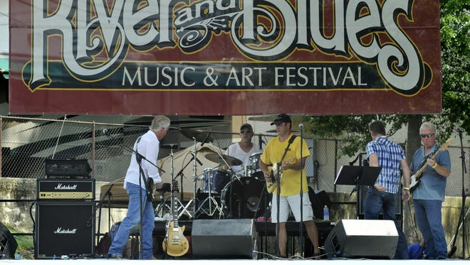 Jimi and the Firedogs play at the Wetumpka River and Blues Music and Arts Festival at Gold Star Park on Saturday, July 19, 2014.