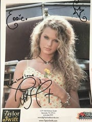 An autographed Taylor Swift photo, given to 92.5 KJJY