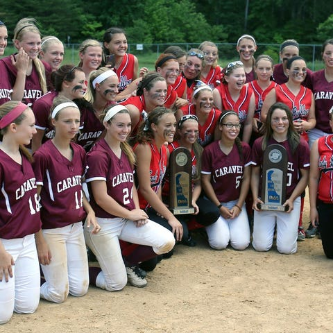 Laurel and Caravel softball team members stand...