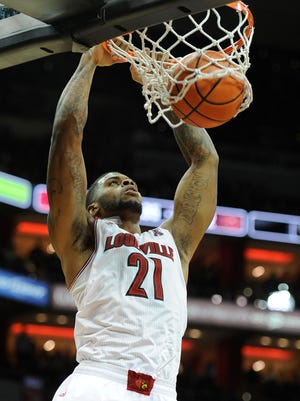 Louisville Cardinals forward Chane Behanan (21) dunks against the Missouri State Bears during the second half at the KFC Yum! Center. Louisville defeated Missouri State 90-60.