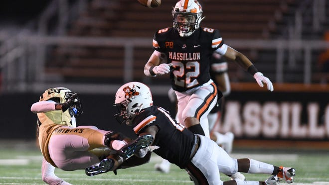 Massillon's Martavien Johnson knocks the ball loose from Warren Harding's Chayne Ringold during the Tigers' Week 3 win on Friday September 11, 2020.