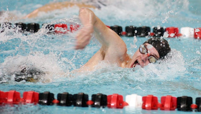 Watkins Memorial freshman Spencer Kleeh competes in the 50 freestyle Monday during a dual against Granville at Denison.