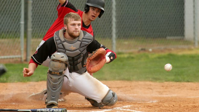 Coshocton senior Andrew Mason fields the ball at home plate Tuesday during the team's 5-3 loss to Tusky Valley.