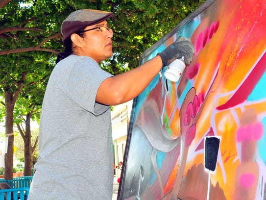 Artist Saba, a native of Farmington, N.M.,  creates